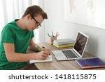 Teenager Boy Doing His Homework ...
