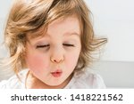 surprised baby close portrait.... | Shutterstock . vector #1418221562