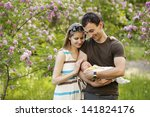 Young Couple With Newborn Son...