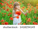children girl in a field with... | Shutterstock . vector #1418254145