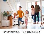 family returning home after... | Shutterstock . vector #1418263115