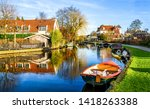 rural village river houses view.... | Shutterstock . vector #1418263388