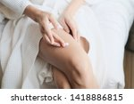 woman applying legs cream... | Shutterstock . vector #1418886815