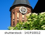 Clock in the tower of Kant's cathedral in Kaliningrad - stock photo