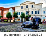 Small photo of Jever, Germany, 09/29/2015: The bull sculpture reminds of the extension of the Jeverland streets in the 1900th century, through which the livestock trading center experienced an upswing.
