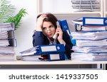 Small photo of Middle-aged businesswoman unhappy with excessive work