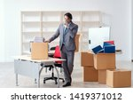 young man employee with boxes... | Shutterstock . vector #1419371012