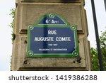"Street name sign in Paris stating: ""Rue Auguste Comte, 1798 -1857, Philosopher and Mathematician"" ""Rue Auguste Comte. 1798 -1857. Philosophe et mathématicien"""