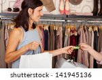 mid adult female customer with...   Shutterstock . vector #141945136