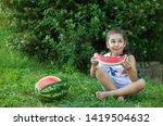 happy little child girl eating... | Shutterstock . vector #1419504632