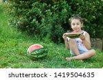 happy little child girl eating... | Shutterstock . vector #1419504635