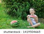 happy little child girl eating... | Shutterstock . vector #1419504665