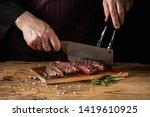 slicing juicy beef steak by... | Shutterstock . vector #1419610925