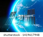 The International Space Station (ISS) is a space station, or a habitable artificial satellite, in low Earth orbit. Satellite view earth and ISS. Element of this images are furnished by Nasa. 3d render