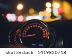 Speedometer scoring high speed in a fast motion. Sporty Car Dashboard Instruments illuminated at night. Rev counter. Modern Vehicle cluster. - stock photo