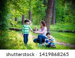 young woman mother applying... | Shutterstock . vector #1419868265