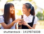 two asian teenager laughing... | Shutterstock . vector #1419876038