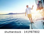 sunrise sailing man on boat in... | Shutterstock . vector #141987802