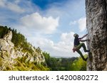 young male climber hanging by a ... | Shutterstock . vector #1420080272