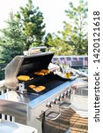 grilling salmon on a gas... | Shutterstock . vector #1420121618