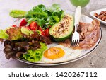 plate with a keto diet food.... | Shutterstock . vector #1420267112