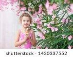 cute little girl eating ice...   Shutterstock . vector #1420337552