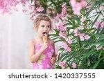 cute little girl eating ice...   Shutterstock . vector #1420337555