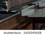 bending sheet metal with a... | Shutterstock . vector #1420345658
