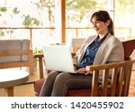 woman working on a laptop on a... | Shutterstock . vector #1420455902