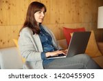 woman working on a laptop on a... | Shutterstock . vector #1420455905