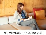 beautiful woman reading a book... | Shutterstock . vector #1420455908