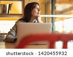woman working on a laptop on a... | Shutterstock . vector #1420455932