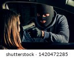 A masked robber with a gun...