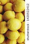 colorful display of lemons in... | Shutterstock . vector #1420522412