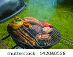 hot grilled food in garden | Shutterstock . vector #142060528