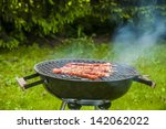 grilling theme with barbecue... | Shutterstock . vector #142062022
