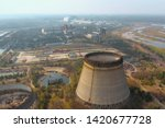 Small photo of Chernobyl nuclear power plant. Cooling tower overlooking the nuclear power plant in Chernobyl. View of the destroyed nuclear power plant. Chernobyl nuclear power plant, aerial view. Chernobyl NPP