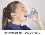 cute smiling girl using an... | Shutterstock . vector #142087072