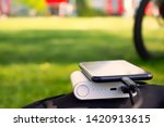 portable charger charges the... | Shutterstock . vector #1420913615