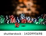 A very close up shot of 2 dice rolling on a green felt table top in very crisp focus, showing 4, 5 and 6 on the faces. - stock photo