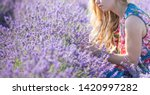a girl with long hair collects... | Shutterstock . vector #1420997282