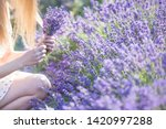 a girl with long hair collects... | Shutterstock . vector #1420997288