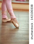 legs a little ballerina in a... | Shutterstock . vector #142100338