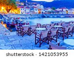 Greece, Europe - scenic twilight scenery of street cafe in ancient Greek harbor Nafpaktos. Nafpaktos was important part of ancient Greece.  Nowdays Nafpaktos is popular travel destination in Greece.