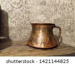 Copper Pot On Wood Background