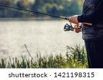 elderly man enjoys fishing by... | Shutterstock . vector #1421198315