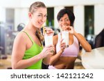 young people   women in the gym ... | Shutterstock . vector #142121242