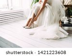 Bride Dresses Shoes Before The...