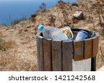 Full Trash Or Litter Bin With...