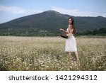 beautiful woman with long...   Shutterstock . vector #1421294312